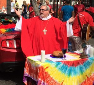 The Rev. Dr. Guy Erwin, bishop of the Southwest California Synod, ELCA, presides at the SoCal Lutheran Street Eucharist at the Los Angeles Pride Parade